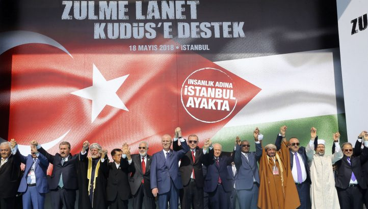 "Turkish President Recep Tayyip Erdogan (6th R), Palestinian Prime Minister Rami Hamdallah (7th R) and other representatives of countries, who have come to Istanbul to attend the extraordinary summit of the Organization of Islamic Cooperation (OIC), greet people as they attend a rally in solidarity with Palestinians after Israeli aggression against civilians on Gaza border, on May 18, 2018 at Yenikapi fairgrounds in Istanbul, Turkey. The rally was launched under the theme of ""Condemning Oppression, Supporting al-Quds [Jerusalem]."" (Kayhan Özer - Anadolu Agency)"